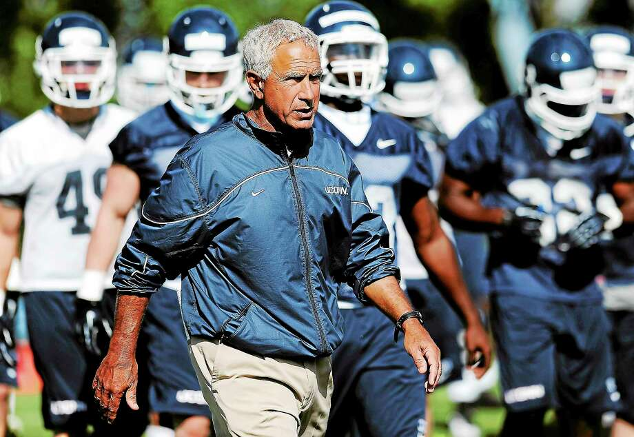 Coach Paul Pasqualoni and the UConn football team will open the season Thursday against Towson. Photo: Jessica Hill — The Associated Press   / FR125654 AP