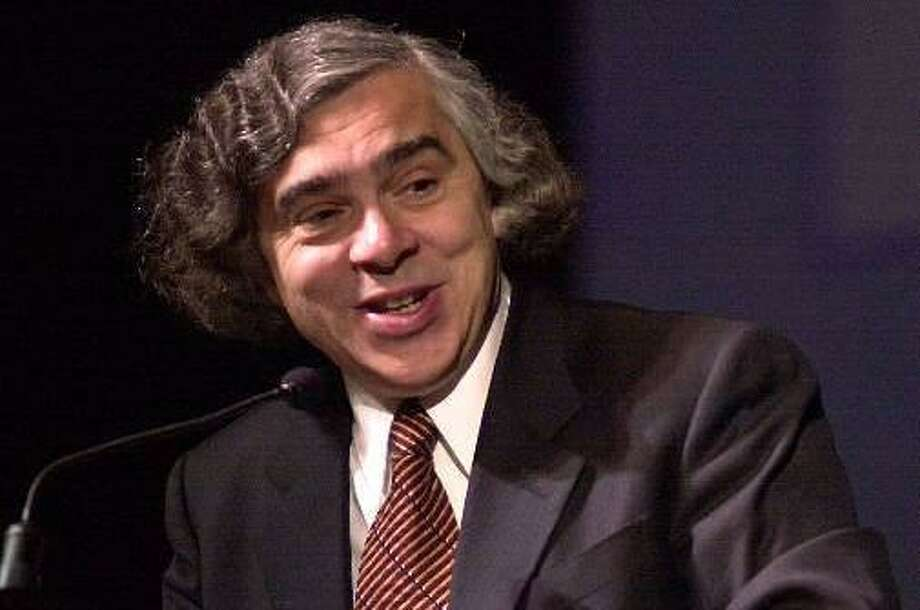 U.S. Undersecretary of Energy Ernest Moniz welcomes participants to a plenary session at the the Asia Pacific Economic Cooperation Energy Ministers Conference in San Diego, Thursday, May 11, 2000. Energy Ministers from 21 countries are taking part in the conference through Friday.  (AP Photo/Denis Poroy) Photo: ASSOCIATED PRESS / AP2000