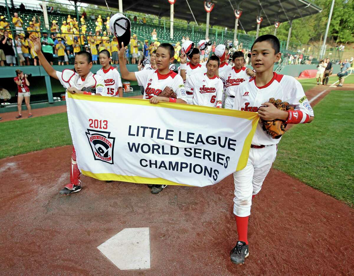 Tokyo, Japan players parade with the championship banner after winning the Little League World Series championship against Chula Vista, Calif., on Sunday.