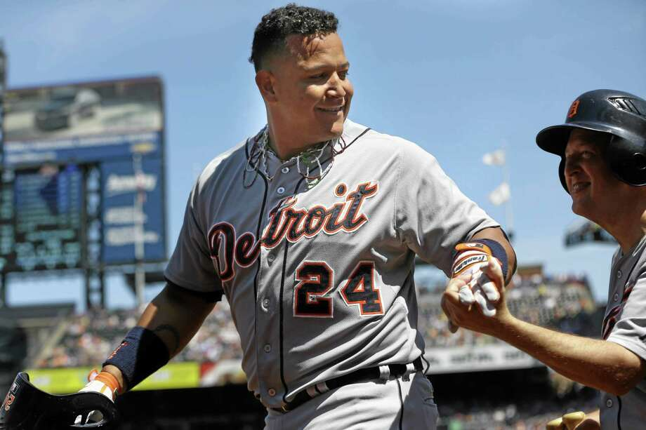 The Tigers' Miguel Cabrera, left, celebrates his two-run home run with a bat boy during the first inning against the Mets on Sunday. Photo: Seth Wenig — The Associated Press   / AP