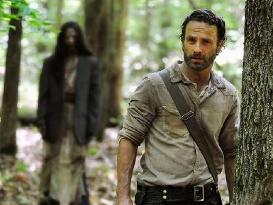"""This image released by AMC shows Andrew Lincoln as Rick Grimes in a scene from the season four premiere of """"The Walking Dead,"""" airing Oct. 13 at 9 p.m. EST. (AP Photo/AMC, Gene Page) Photo: AP / AMC"""