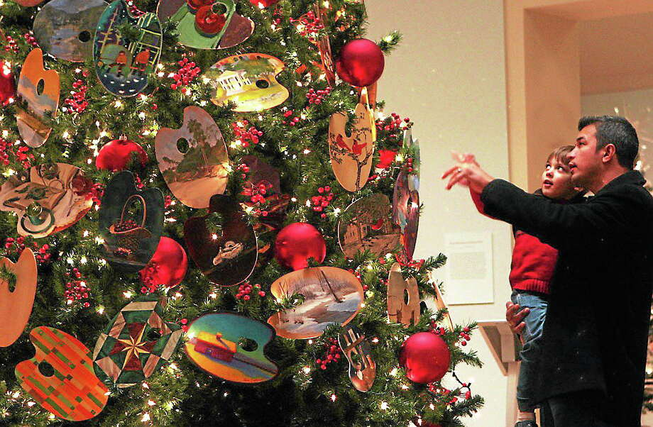 Christmas trees at Flo Gris are decorated with 145 palettes. The exhibit continues through the holidays until Jan. 6. Photo: Journal Register Co.