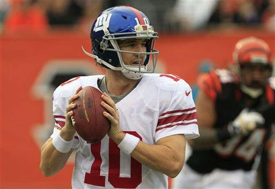 New York Giants quarterback Eli Manning. (AP Photo/Al Behrman) Photo: AP / AP