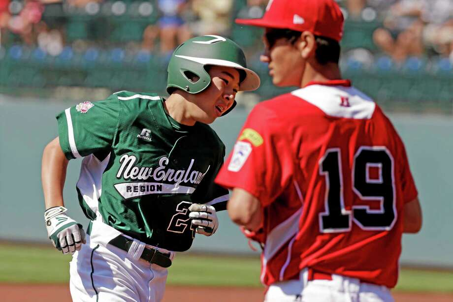 Westport, Conn.'s Chad Knight, left, rounds third past Tijuana, Mexico, third baseman Luis Manzo (19) after hitting a two-run home run off Mexico's, pitcher Miguel Artalejo in the first inning of a consolation baseball game at the Little League World Series tournament in South Williamsport, Pa., Sunday, Aug, 25, 2013. (AP Photo/Gene J. Puskar) Photo: AP / AP