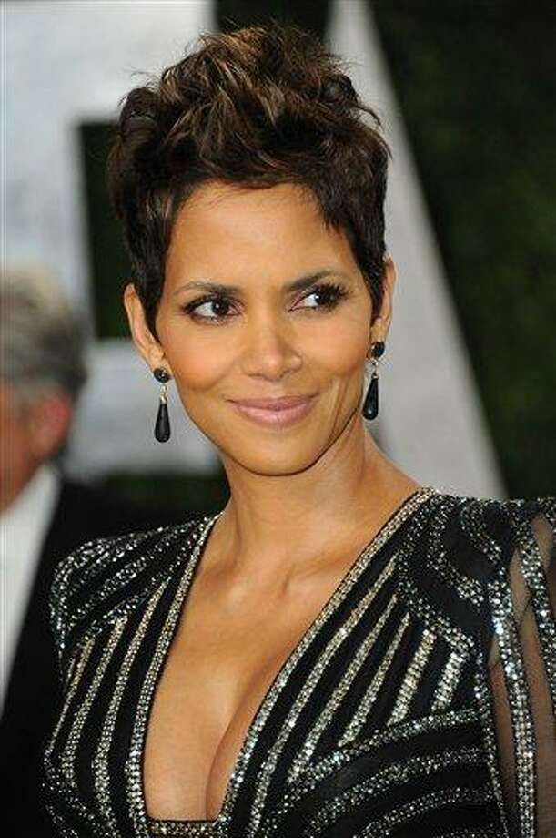 """FILE - This Feb. 24, 2013 file photo shows actress Halle Berry at the 2013 Vanity Fair Oscar party at the Sunset Plaza Hotel in West Hollywood, Calif. The Oscar-winning actress had hoped to move to France with 4-year-old Nahla and Berry's fiance, Oliver Martinez. But a judge in her custody dispute with Nahla's father, Gabriel Aubry, prevented that last year. Berry says she's now trying to figure out how to make life """"more normal"""" for Nahla in the Los Angeles area, where they live.  (Photo by Jordan Strauss/Invision/AP, file) Photo: Jordan Strauss/Invision/AP / Invision"""