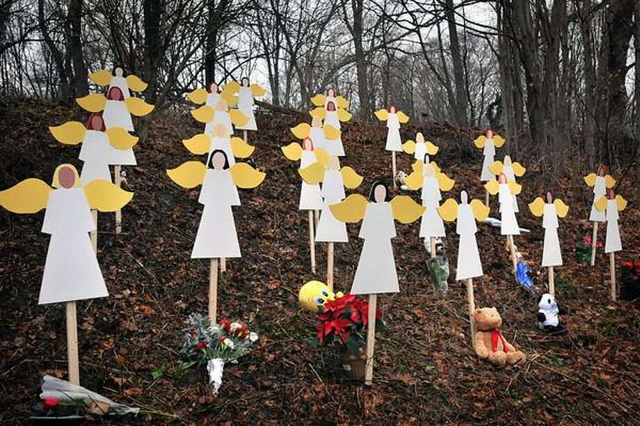 Newtown--A display of wooden angels with the names of the slain children near the center of Sandy Hook. They are from Danbury. Photo-Peter Casolino 12/16/12