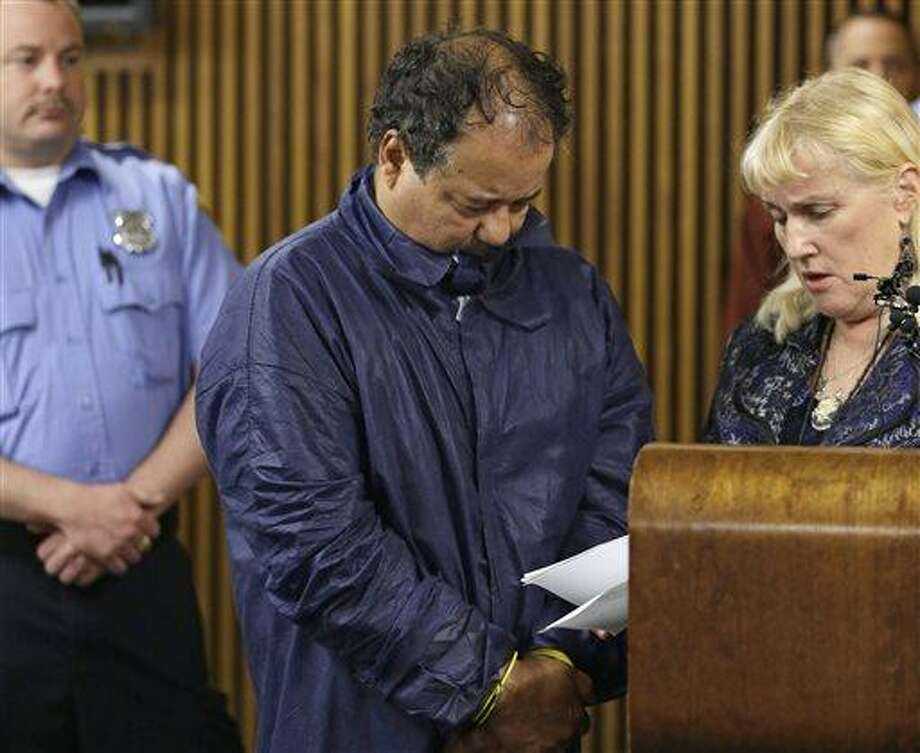 Ariel Castro appears in Cleveland Municipal court alongside defense attorney Kathleen DeMetz, right, Thursday, May 9, 2013, in Cleveland. Castro was charged with four counts of kidnapping and three counts of rape after three women missing for about a decade and one of their young daughters were found alive at his home earlier in the week. (AP Photo/Tony Dejak) Photo: AP / AP