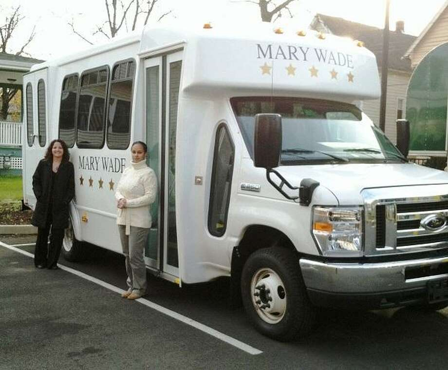Pictured with the new vehicle is Tracy Gilbert, MSW, Director of Adult Day Health and Transportation Services and Lorena, Coordinator of Transportation.