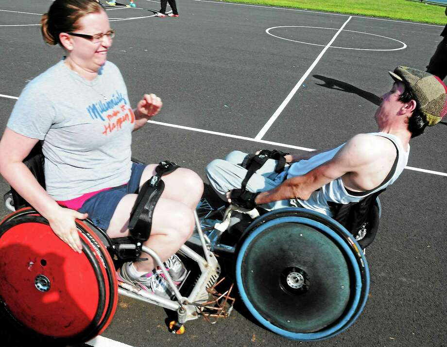 Mara Lavitt — Register August 17, 2013 New Haven. McClain Park, New Haven. Jon Sigworth of Hamden, right, brought wheelchairs used for rugby to McClain Park in New Haven for anyone to try out, as part of fundraising for a Delhi, India team Sigworth founded. Tori Rowe of New Britain collides with Sigworth. Photo: Journal Register Co.