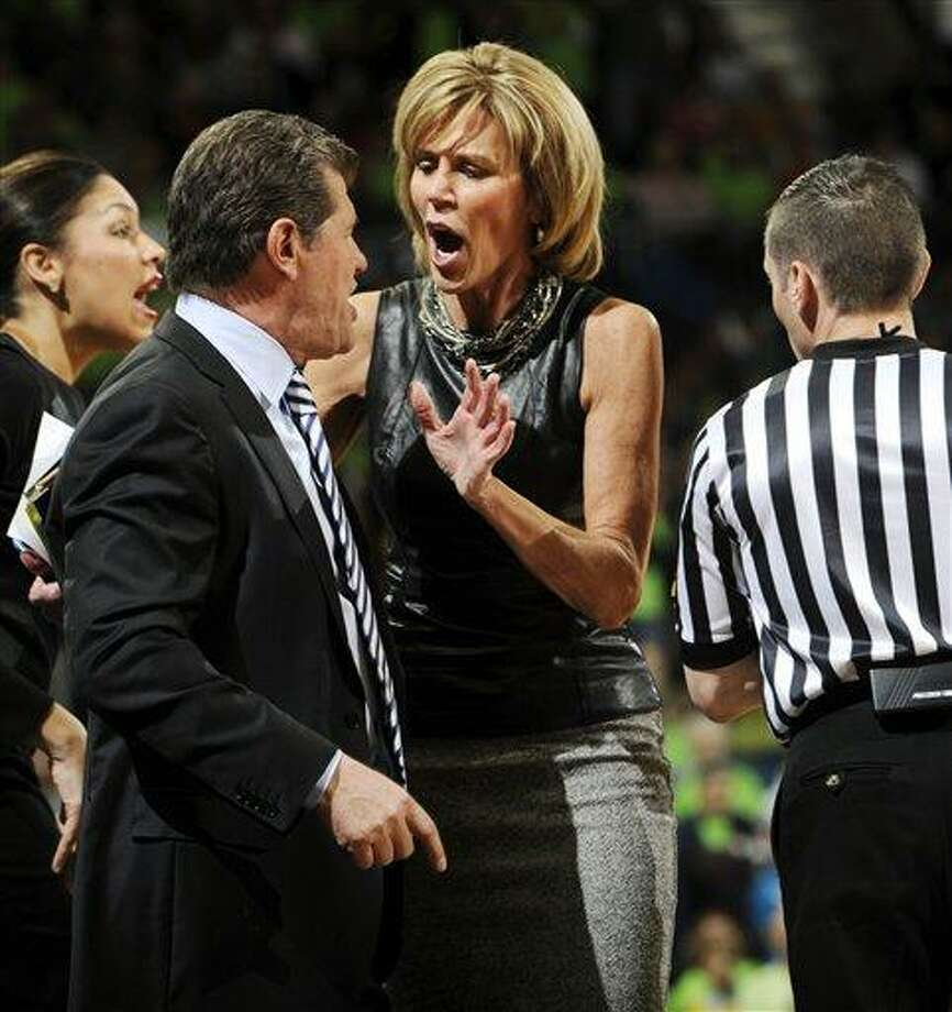 Connecticut associate head coach Chris Dailey, center, tries to calm head coach Geno Auriemma after Auriemma received a technical foul during the first half of an NCAA college basketball game against Notre Dame, Monday, March 4, 2013, in South Bend, Ind. (AP Photo/Joe Raymond) Photo: AP / FR25092 AP
