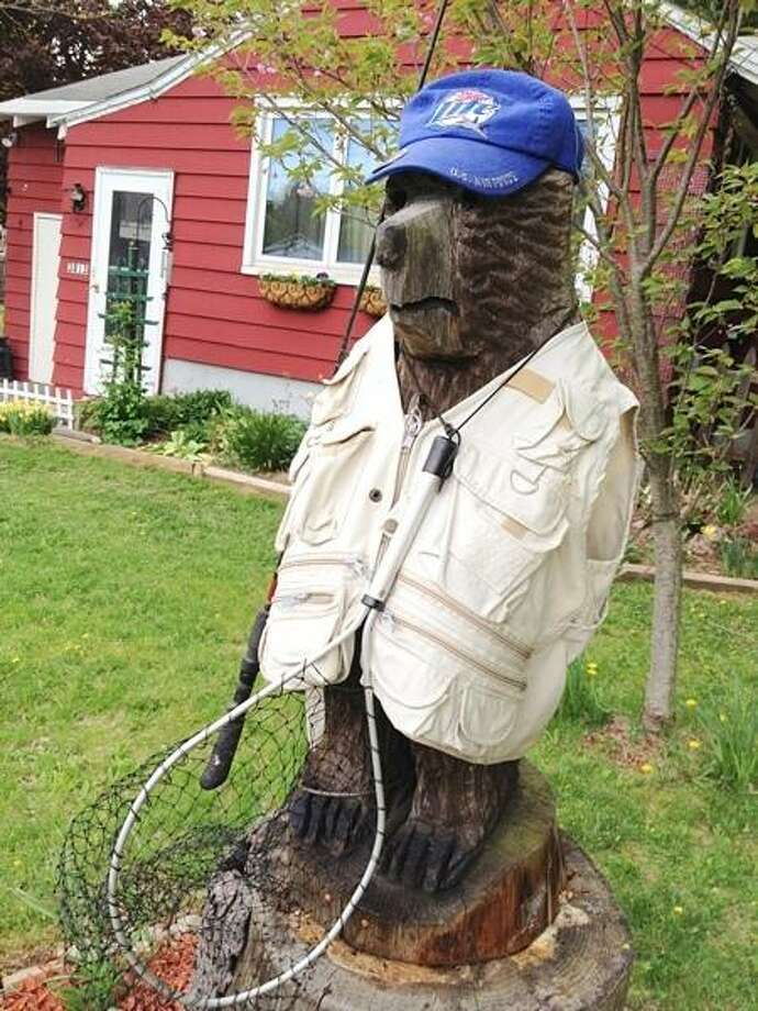 PHOTO BY JOHN HAEGER @ ONEIDAPHOTO ON TWITTER/ONEIDA DAILY DISPATCH A carved bear at 3813 Sconondoa Road on Wednesday, May 8, 2013.