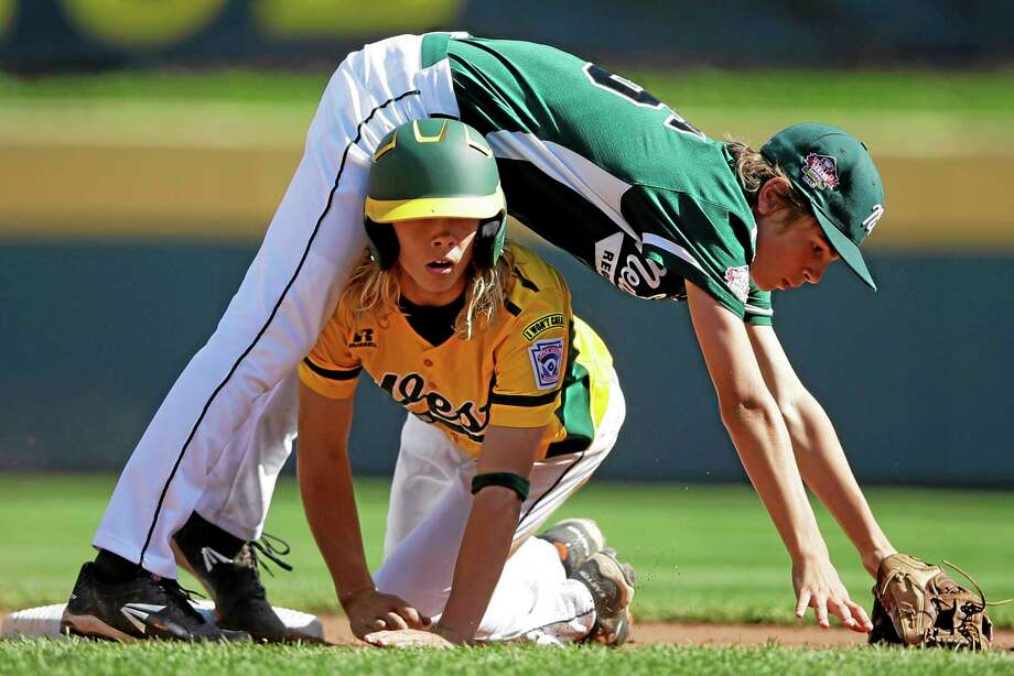 California's Micah Pietila-Wiggs, bottom, breaks up a double play as Westport second baseman Max Popken falls over him during the first inning Saturday. Photo: Matt Slocum — The Associated Press   / AP