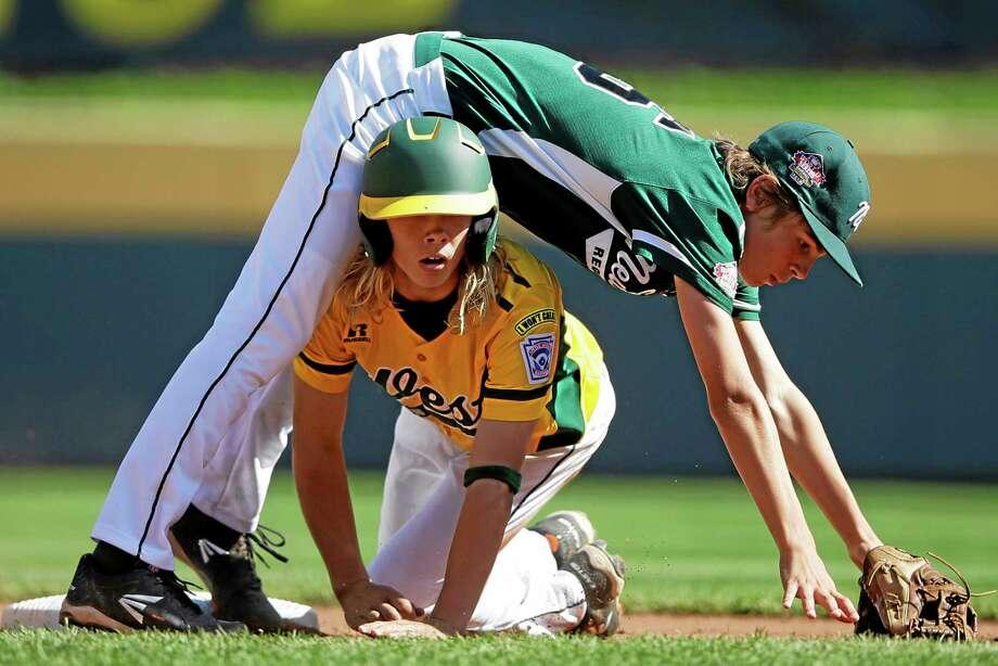 California's Micah Pietila-Wiggs, bottom, breaks up a double play as Westport second baseman Max Popken falls over him during the first inning Saturday. Photo: Matt Slocum — The Associated Press   / AP