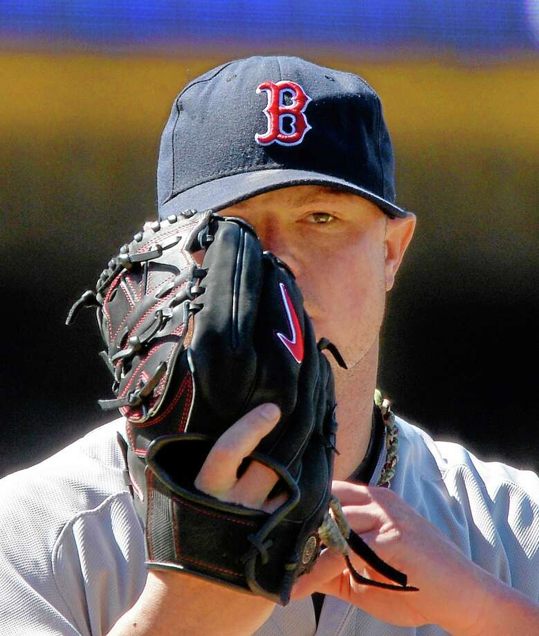 Red Sox starting pitcher Jon Lester gets set to throw to the plate during the seventh inning Saturday in Los Angeles. Photo: Merk J. Terrill — The Associated Press   / AP