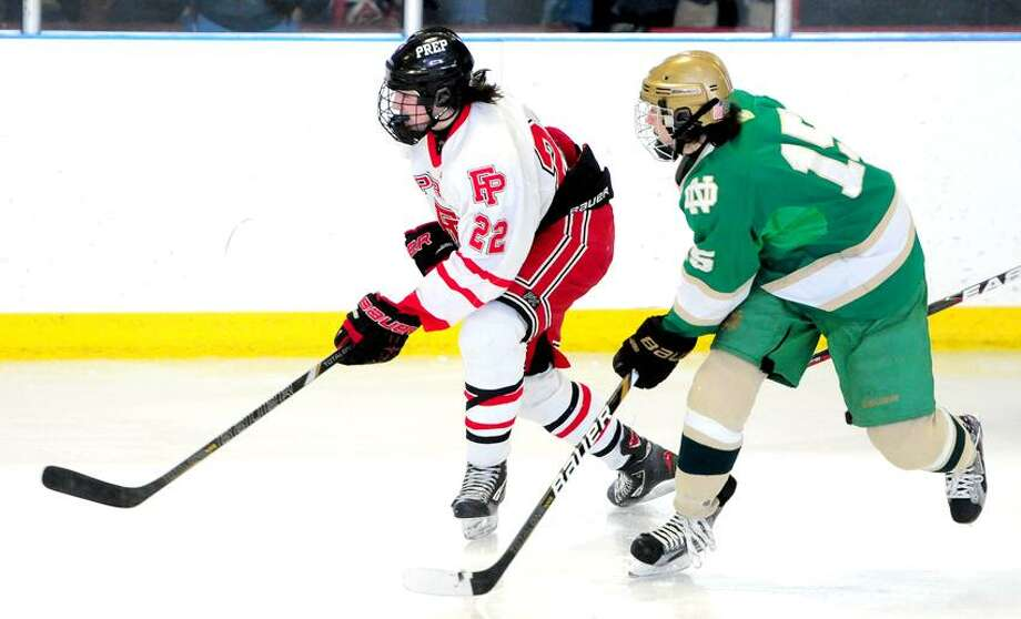 Dean Lockery (left) of Fairfield Prep maneuvers toward the puck with Matthew Dumas (right) of Notre Dame of West Haven in Bridgeport on 2/16/2013.Photo by Arnold Gold/New Haven Register