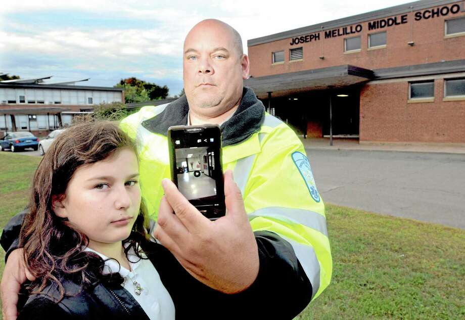 Angelo Appi Jr. of North Haven with his daughter Gianna, age 11 of East Haven. Appi took a cellphone video when he went to pick up Gianna after school at Joseph Melillo Middle School in East Haven and found the door wide open. Photo: Mara Lavitt — New Haven Register   / Mara Lavitt
