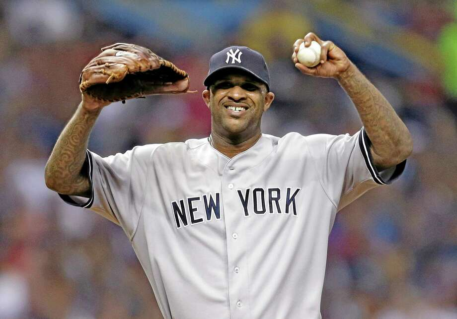 New York Yankees starting pitcher CC Sabathia reacts after giving up three runs to the Tampa Bay Rays during the sixth inning Saturday. Photo: Chris O'Meara — The Associated Press   / AP