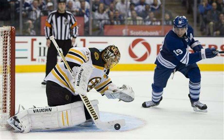 Boston Bruins goaltender Tuukka Rask makes a save as Toronto Maple Leafs' Joffrey Lupul closes in during the second period of Game 4 of their NHL hockey Stanley Cup playoff series, Wednesday, May 8, 2013, in Toronto. (AP Photo/The Canadian Press, Frank Gunn) Photo: AP / The Canadian Press