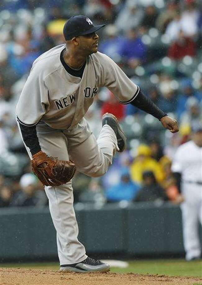 New York Yankees starting pitcher CC Sabathia works against the Colorado Rockies in the first inning of a baseball game in Denver on Thursday, May 9, 2013. (AP Photo/David Zalubowski) Photo: AP / AP