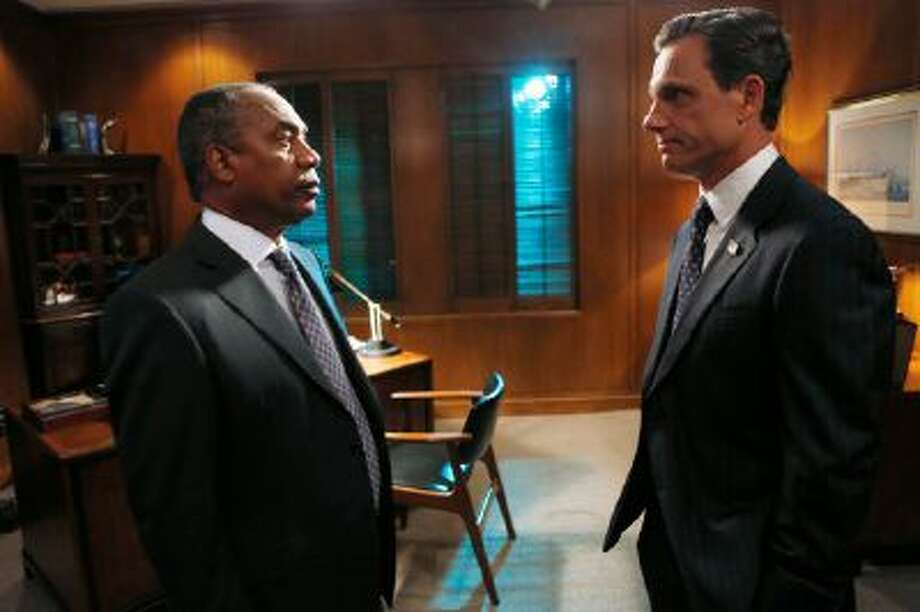"""This photo provided by ABC shows Joe Morton, left, and Tony Goldwyn, in a scene from the TV series, """"Scandal,"""" Thursdays, (10:00-11:00 p.m., ET) on the ABC Television Network."""