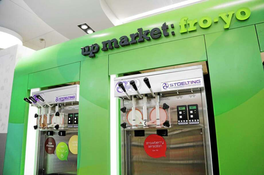 The Walgreens flagship store in the Empire State Building in New York features frozen yogurt machines.The nation's major drugstore chains are opening more in-store clinics in response to the massive U.S. health care overhaul, which is expected to add about 25 million newly insured people who will need medical care and prescriptions, as well as  offering more services as a way to boost revenue in the face of competition from stores like Safeway and Wal-Mart. Photo: Mark Lennihan — The Associated Press Photos   / AP