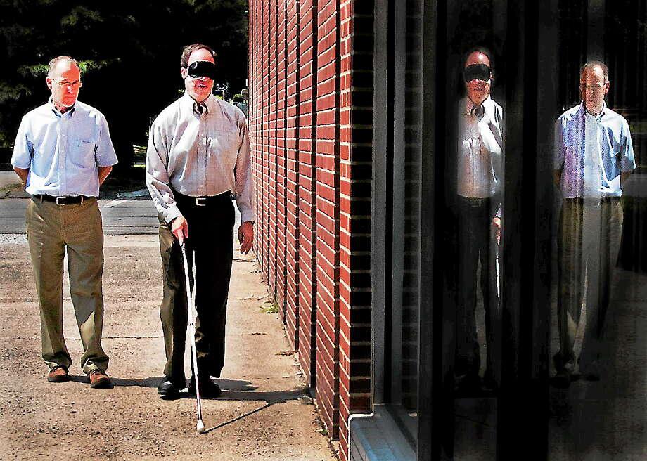 Melanie Stengel — Register       John Waiculonis (L) watches reporter Ed Stannard as he returns from an outdoor walk 8/20. Photo: Journal Register Co.