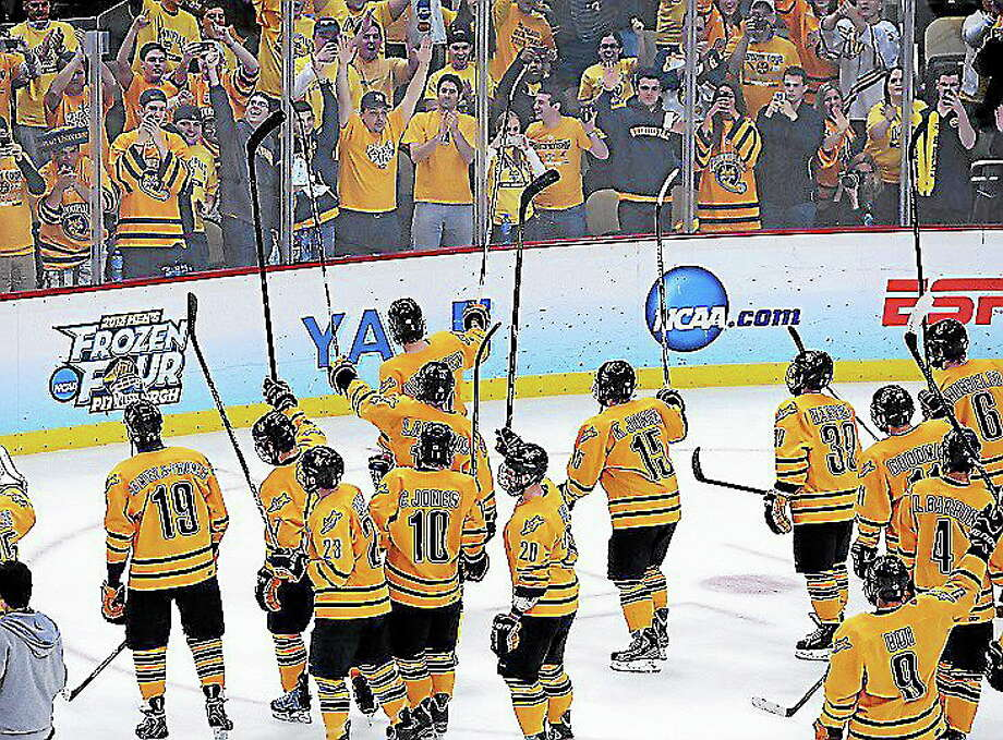 Quinnipiac waves to its fans after beating St. Cloud State 4-1 to advance to the national championship game in April in Pittsburgh. Photo: Peter Casolino — Register