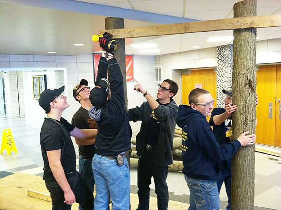 Dispatch Staff Photo by NICK WILL Vernon-Verona-Sherrill FFA members Billy Terrell, Tate Tiller, Joe Brown, Kenny Stover, and Chris March set up tree displays for the  Maple Conference on Jan. 4 and 5, 2013.