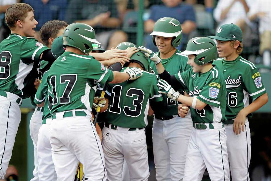 Westport, Conn.'s Tatin llamas (13) is greeted by teammates after hitting a two-run home run during the second inning of an elimination baseball game against Sammamish, Wash. at the Little League World Series tournament, Friday, Aug. 23, 2013, in South Williamsport, Pa. (AP Photo/Matt Slocum) Photo: AP / AP