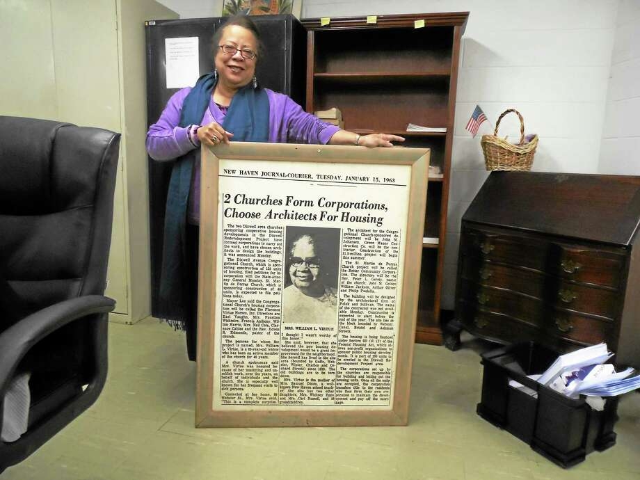 Sharyn Esdaile holds a copy of a story about Florence Virtue, done by the New Haven Courier-Journal 1963 Photo: Journal Register Co. / Copyright 2012