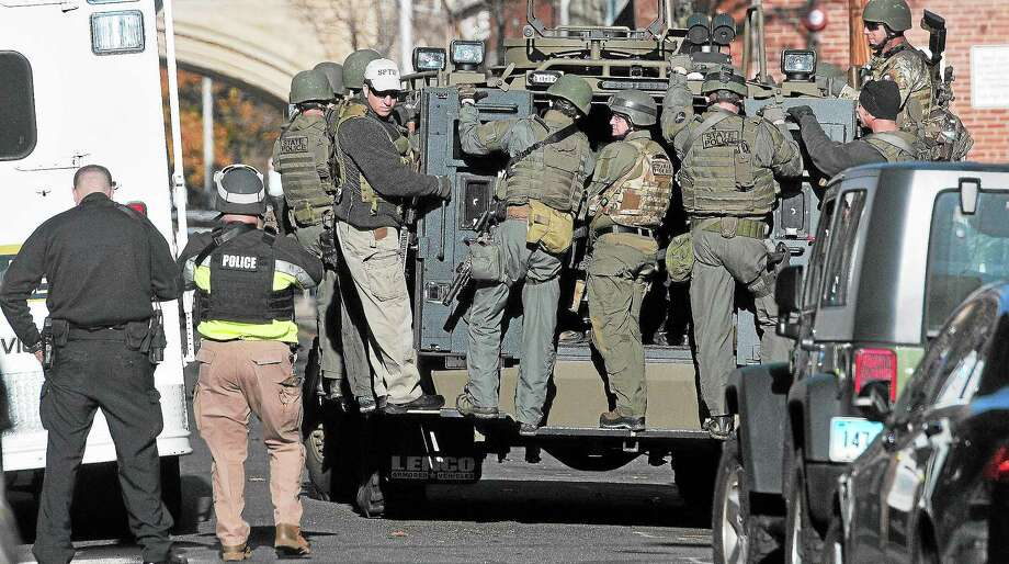 (Peter Casolino — New Haven Register)   SWAT teams stage along High Street during the Yale lockdown Monday Morning. pcasolino@NewHavenRegister Photo: Journal Register Co.