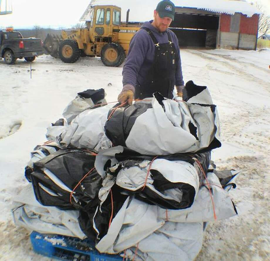 "Dispatch Staff Photo by JOHN HAEGER <a href=""http://twitter.com/oneidaphoto"">twitter.com/oneidaphoto</a> Rich Carrier of ABC Farms shows the plastic which came from the bunk silo which will now be able to be recycled through  the  AG Plastic collection program. The program is the first step in a public/private partnership between Madison County and JBI, Inc. of Niagara Falls. JBI who have ""cracked the code"" and are currently turning plastic into oil. ABC farms used about 2000 pounds of plastic a year."