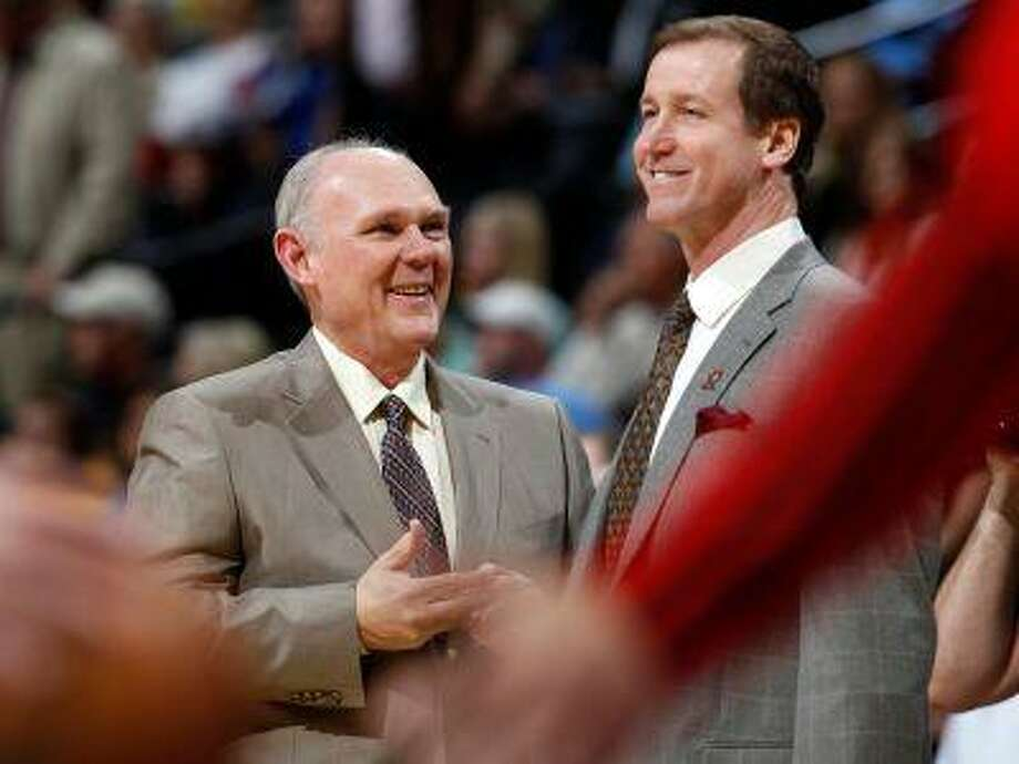Denver Nuggets head coach George Karl, left, jokes with Portland Trail Blazers head coach Terry Stotts before an NBA basketball game in Denver, Sunday, April 14, 2013. (AP Photo/David Zalubowski) Photo: ASSOCIATED PRESS / AP2013