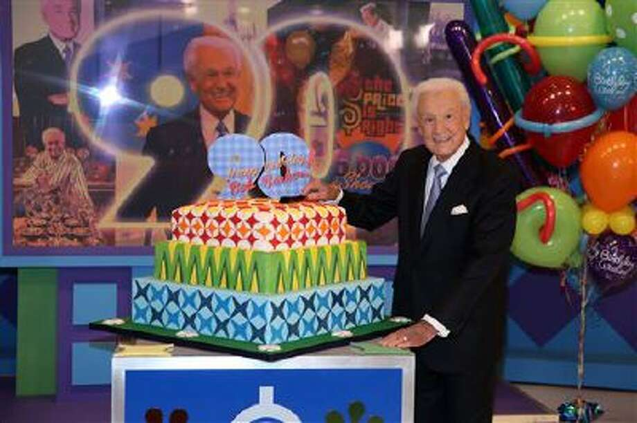 """This Nov. 5, 2013 photo shows Bob Barker posing on the set of """"The Price is Right"""" with a cake celebrating his 90th birthday at CBS Studios in Los Angeles. The veteran game show host, at the helm of ?The Price is Right? from 1972 to 2007, was invited back by current host Drew Carey on Thursday, Dec. 12, to celebrate the milestone birthday. Photo: Matt Sayles/Invision/AP / Invision"""
