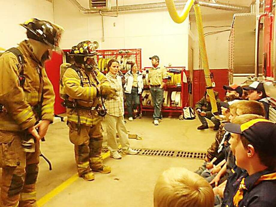 SUBMITTED PHOTO  The Munnsville Pack 7 Cub Scouts took their annual trip to the Munnsville Volunteer Fire Department on Jan. 2.