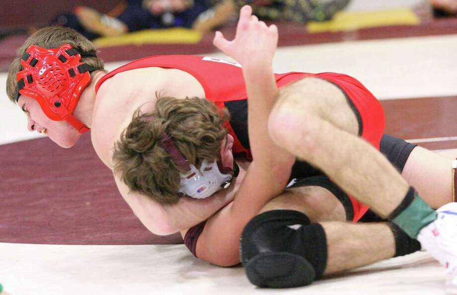 """Dispatch Staff Photo by JOHN HAEGER <a href=""""http://twitter.com/oneidaphoto"""">twitter.com/oneidaphoto</a> Chittenango's Rob Tyson, top, scores the winning back points as time expires against Canastota's Mike Zupan in their 113-pound match in Canastota's Dick New Memorial Tournament on Friday. Tyson won 7-6 to advance to the next round."""