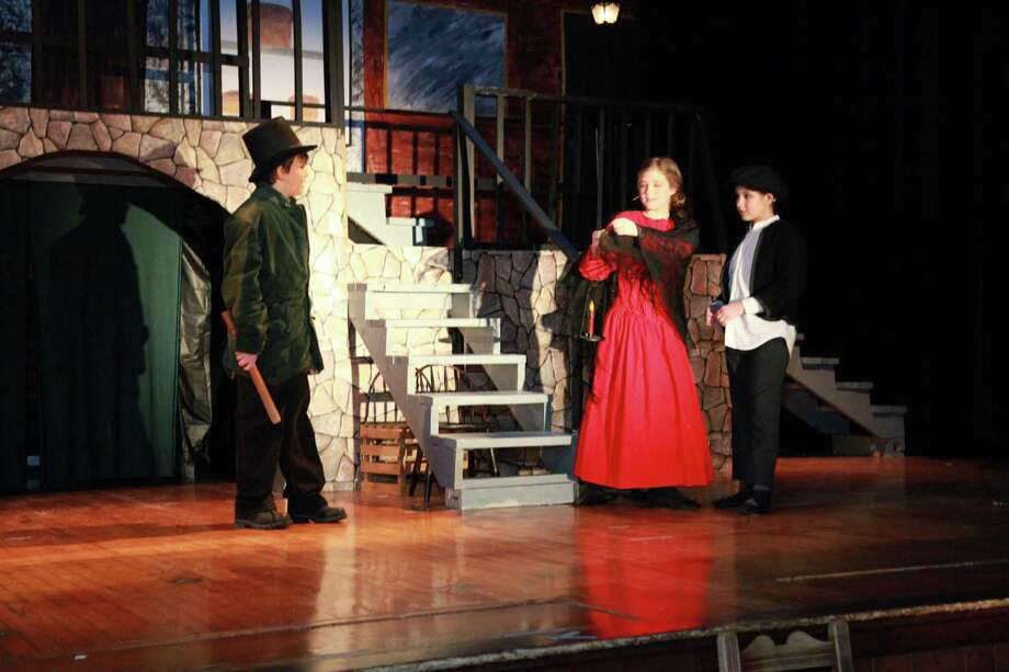 Photo Provided by E.R. Andrews Elementary School and Ian Domes From left are Zachary Strong, who plays Bill Sikes, Alexis LaFever, who plays Nancy, and Victoria Sgarlata, who plays Oliver, rehearsing on stage.