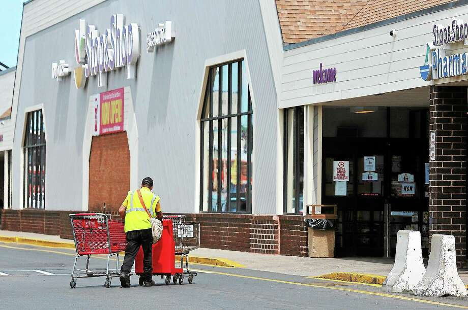 Peter Casolino — Register A Stop&Shop employee retrieves carts from the lot at the Dixwell Avenue store in Hamden. The store is slated to close in October.pcasolino@newhavenregister.com Photo: Journal Register Co.