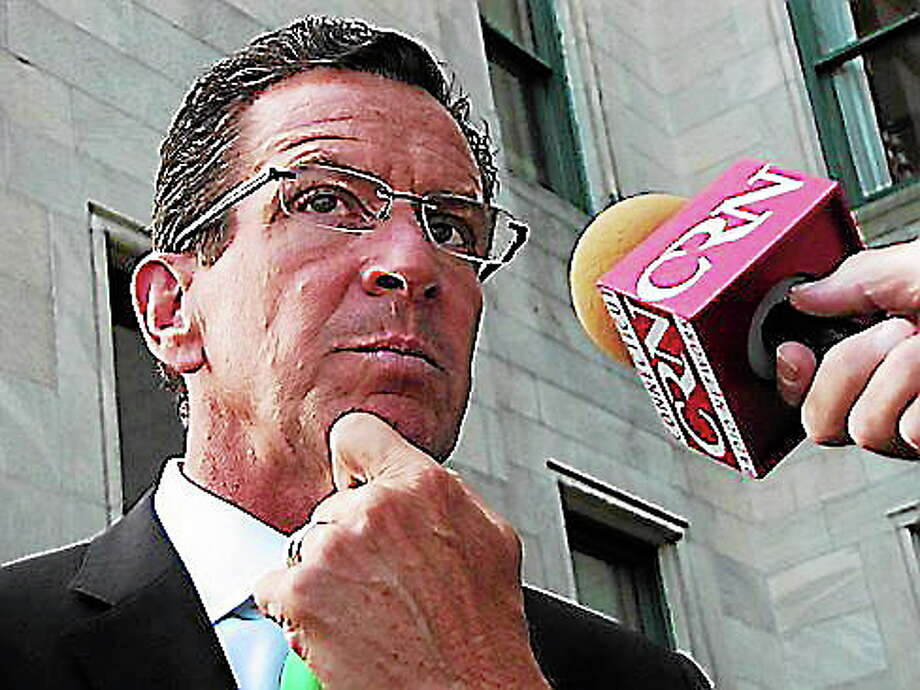 Hugh McQuaid/CT NewsJunkieGov. Dannel P. Malloy answers questions from reporters Friday. Photo: Journal Register Co.