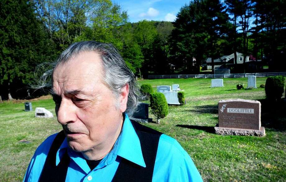 Franz Douskey of Hamden is photographed near the grave of Thornton Wilder at the Mount Carmel Burying Ground on Whitney Ave. in Hamden on 5/7/2013.Photo by Arnold Gold/New Haven Register   AG0496