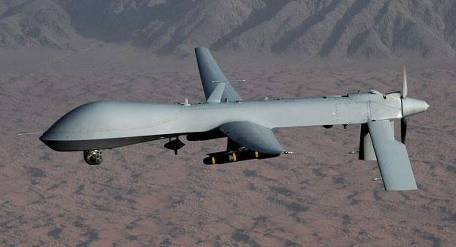 A drone is pictured over desert terrain. AP image