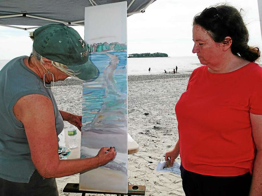 SUBMITTED PHOTO - STEVE JOHNSONMaryann Kling, right, discusses the work of Milford artist Elizabeth B. Wright, left, at Silver Sands State Park in Milford. Photo: Journal Register Co.