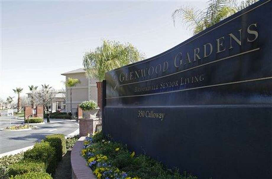 """Shown is the main gate of Glenwood Gardens in Bakersfield, Calif., Monday March 4, 2013, where an elderly woman died after a nurse refused to perform CPR on her last week. The central California retirement home is defending one of its nurses who refused pleas by a 911 operator to perform CPR on an elderly woman, who later died. """"Is there anybody that's willing to help this lady and not let her die,"""" dispatcher Tracey Halvorson says on a 911 tape released by the Bakersfield Fire Department aired by several media outlets. (AP Photo/Gosia Wozniacka) Photo: AP / AP"""
