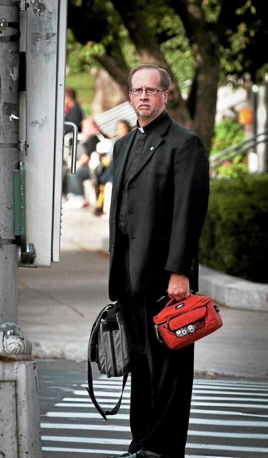 The Rev. James Manship leaves court in Hartford earlier this week. Photo: Mara Lavitt — New Haven Register