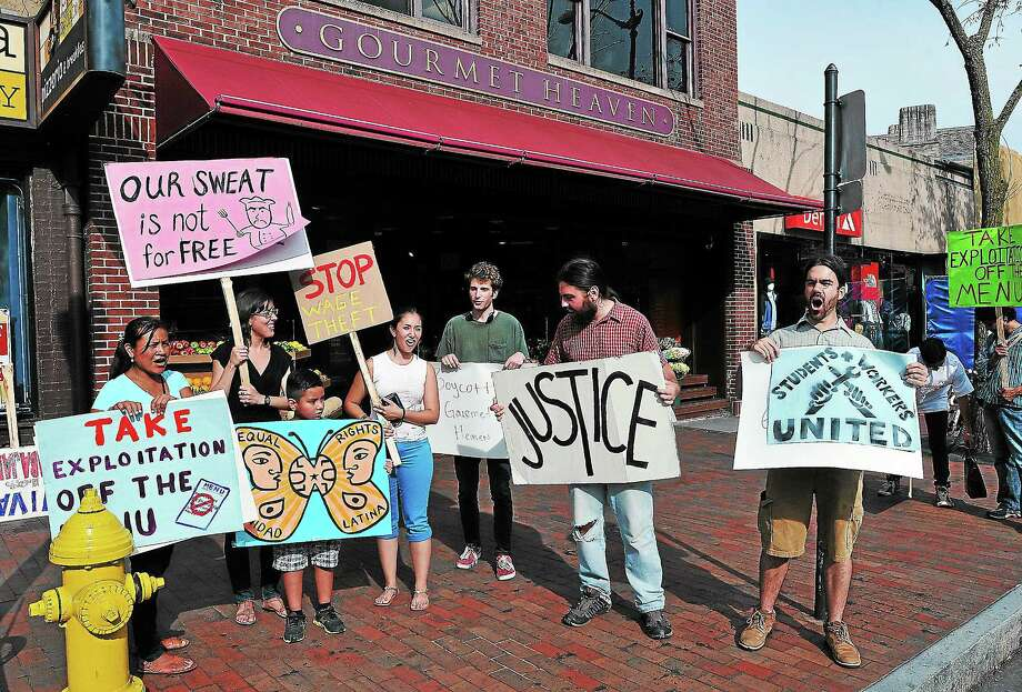 Peter Casolino — Register Employees and their supporters protest outside of Gourmet Heaven late Friday afternoon.pcasolino@newhavenregister.com Photo: Journal Register Co.