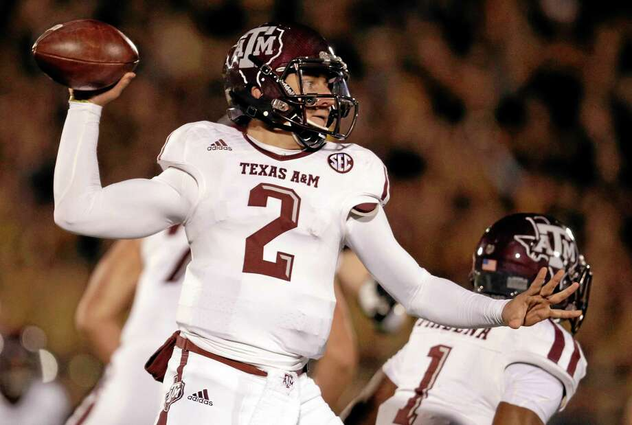 Texas A&M quarterback Johnny Manziel throws during the Aggies' Nov. 30 game against Missouri in Columbia, Mo. Manziel is one of five finalists for the Walter Camp Player of the Year award. Photo: Jeff Roberson — The Associated Press   / AP