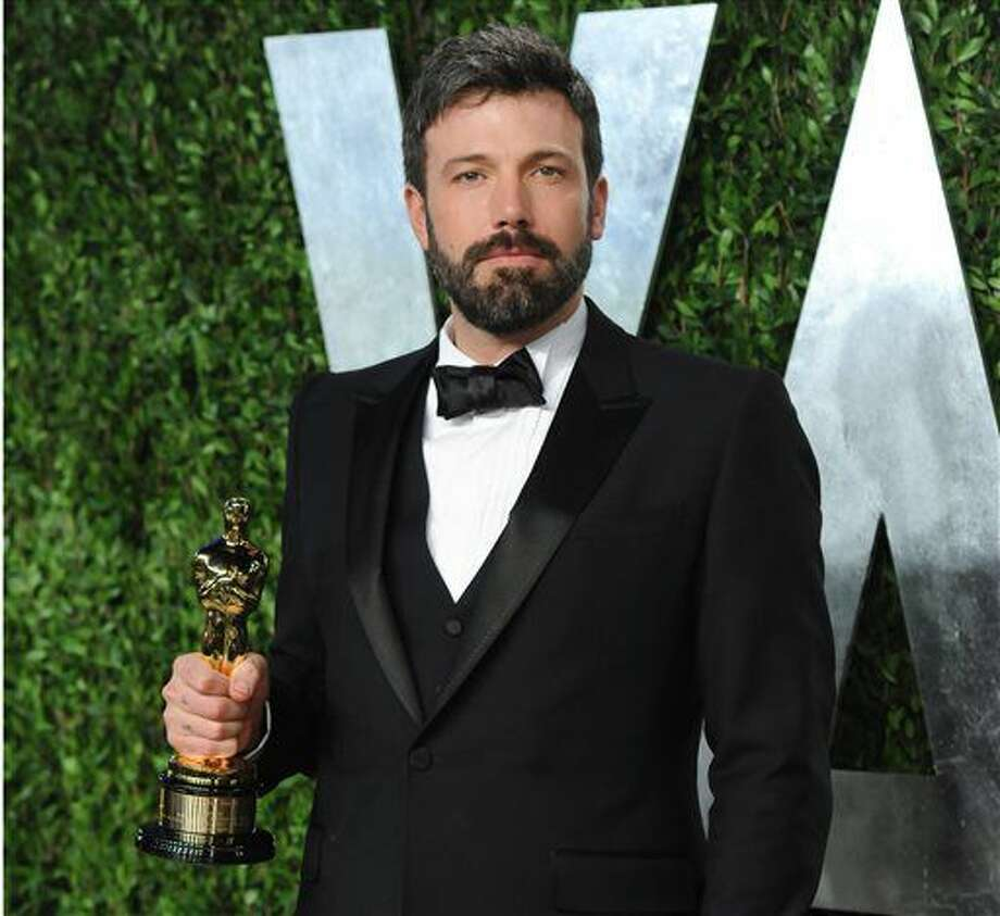 FILE - In this Feb. 24, 2013 photo, actor/director Ben Affleck arrives at the 2013 Vanity Fair Oscars Viewing and After Party, at the Sunset Plaza Hotel in West Hollywood, Calif. Affleck will don Batman's cape and cowl. Warner Bros. announced Thursday, Aug. 22, 2013, that he would star as a new incarnation of the Dark Knight in a film bringing Batman and Superman together. (Photo by Evan Agostini/Invision/AP, File) (Evan Agostini)