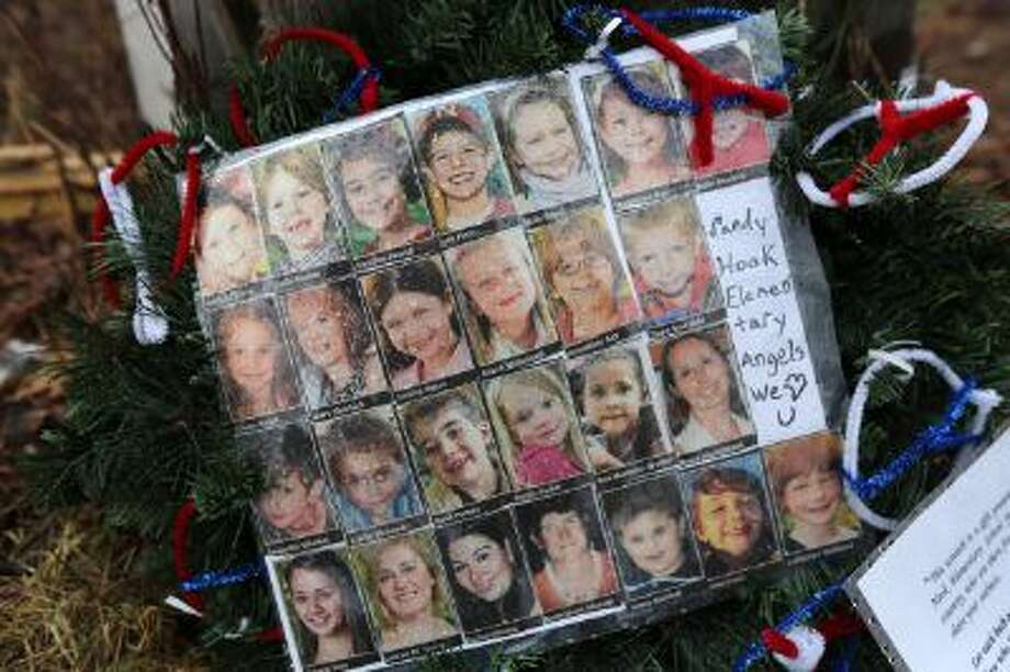 A memorial for the 26 students and educators killed in a mass shooting at Sandy Hook Elementary School in Newtown, Conn., stands shortly after the shooting. One year later, it's not clear how the tragedy impacted America. Photo: Getty Images / 2013 Getty Images