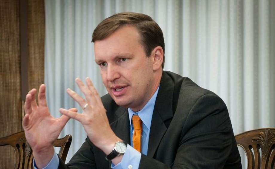New Haven-- Chris Murphy speaks to editorial staff at the New Haven Register.   Melanie Stengel/Register