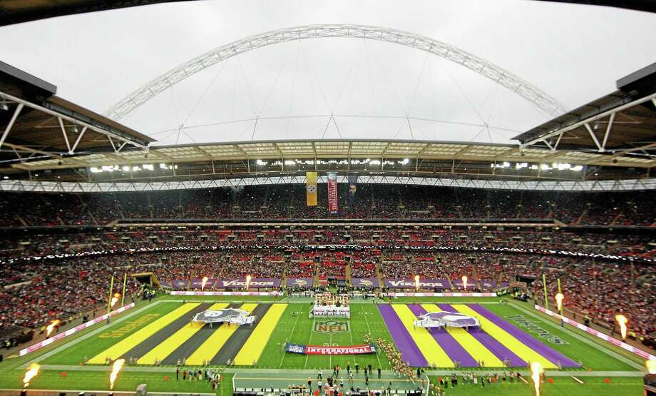 Team flags are displayed on the field ahead of the game between the Pittsburgh Steelers and Minnesota Vikings at Wembley Stadium in London on Sept. 29. Photo: Nicky Hayes -- The Associated Press   / NFL UK